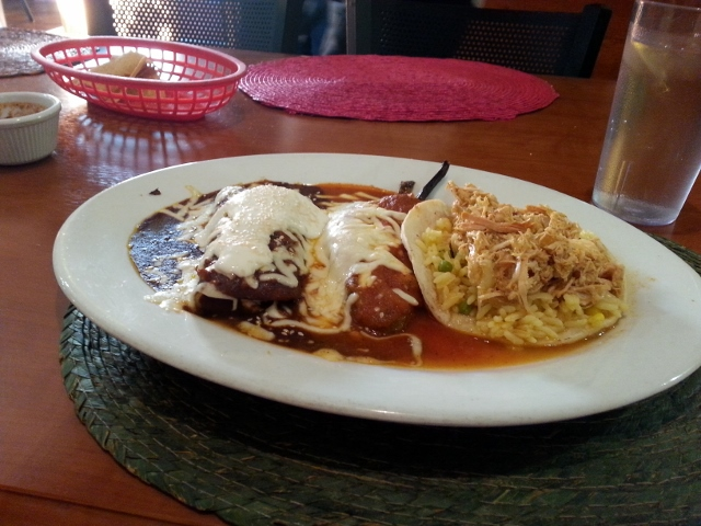 Poblano Combo with chicken in mole sauce, chiles rellenos and chicken taco