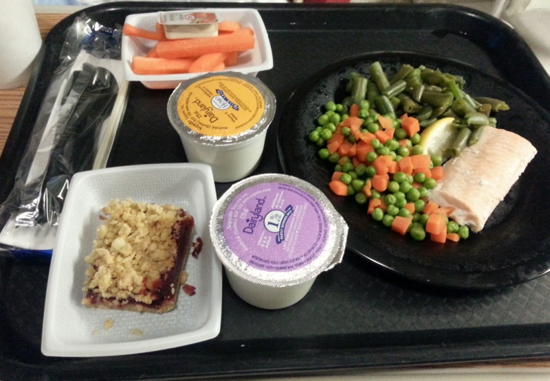 Dinner Poached salmon with green beans, peas, carrots, carrot sticks, berry crumble and milk