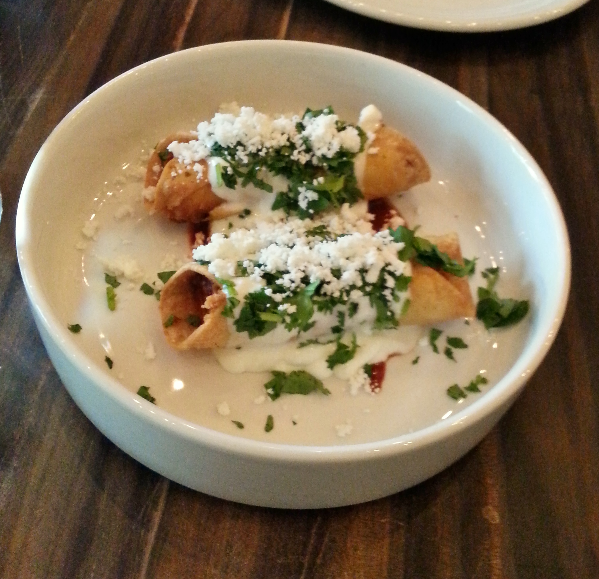 Taquitos potato & sheeps milk cheese, salsa de ajo, crema, queso fresco